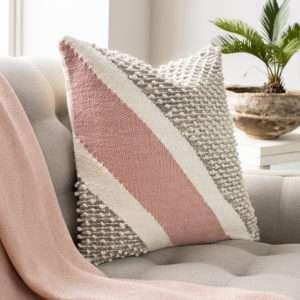 pink wool throw pillow on sofa