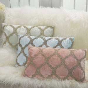 3 velvet lumbar pillows in pink blue and white on white faux fur